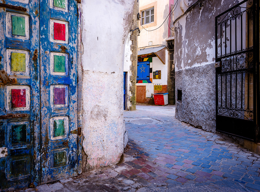 ESSAOUIRA, MOROCCO - CIRCA MAY 2018:  View  of typical alleyway and doors in the citadel of Essaouira.