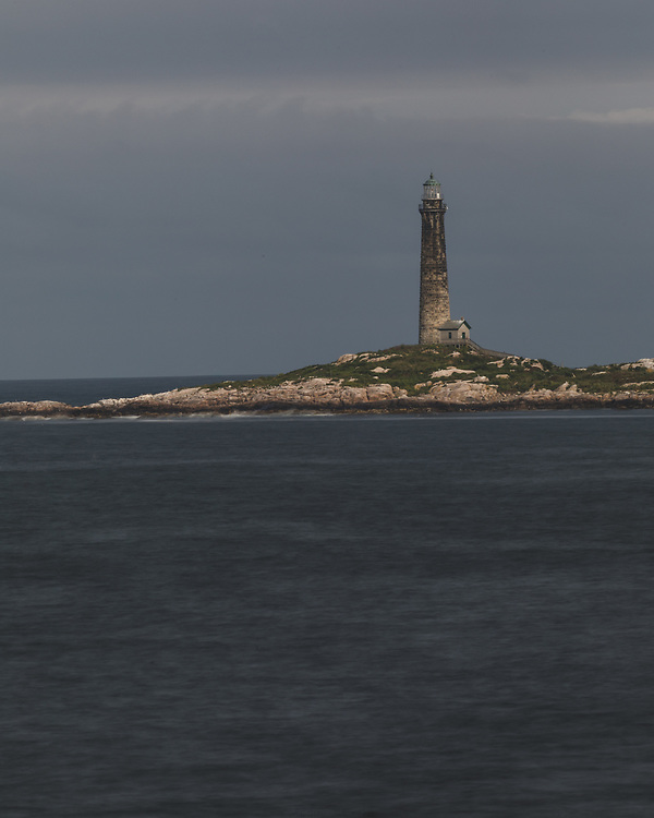 One of Thacher Island's twin lights standing tall of the coast of Cape Ann.