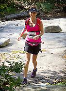 Kernhonkson, New York - Amy Hanlon runs along the trail at Minnewaska State Park Preserve during the Shawangunk Ridge Trail Run/Hike 32-mile race  on Sept. 20, 2014.