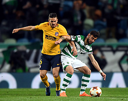 LISBON, April 13, 2018  Bruno Fernandes (R) of Sporting vies with Koke of Atletico during the Europa League quarterfinal second leg soccer match between Sporting CP and Club Atletico de Madrid at the Jose Alvalade stadium in Lisbon, Portugal, on April 12, 2018. Sporting won 1-0 but was eliminated by a 1-2 on aggregate. (Credit Image: © Zhang Liyun/Xinhua via ZUMA Wire)