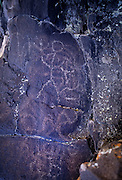 A native american petroglyph at Petroglyph Lake. Old scratchings covered by newer, probably vandalism. Hart Mountain National Wildlife Refuge, Oregon.