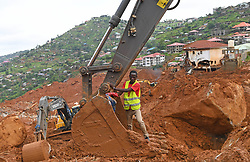 FREETOWN, Aug. 17, 2017  Rescuers utilize a digging machine to clear the debris on the site of the mudslide in Freetown, capital of Sierra Leone, on Aug. 17, 2017. Altogether 331 bodies have been taken to the morgue by the rescue team following the devastating mudslide, according to Sinneh Kamara, head of the Connaught Mortuary in Freetown, capital of Sierra Leone, on Thursday. (Credit Image: © Chen Cheng/Xinhua via ZUMA Wire)