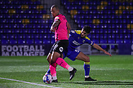 AFC Wimbledon defender Will Nightingale (5) battles for possession with Peterborough United attacker Jonson Clarke-Harris (9) during the EFL Sky Bet League 1 match between AFC Wimbledon and Peterborough United at Plough Lane, London, United Kingdom on 2 December 2020.