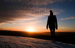 © Licensed to London News Pictures. <br /> 02/01/2017. <br /> Kirkbymoorside, UK.  <br /> <br /> A woman stands and looks out as the sun rises over a frost covered North Yorkshire Moors near Kirkbymoorside.<br /> <br /> Photo credit: Ian Forsyth/LNP