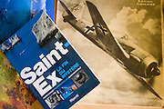 The mystery of Antoine Saint Exupery's disappearance is most likely solved by the testimony of a former Luftwaffe Messerschmitt pilot, Horst Rippert, who attests to shooting down the famous author of 'The Little Prince', who was flying a twin-tailed Lightning P-38 plane, flying below him. The chain bracelet, wrist tag, was found off the coast of Marseille in 1998, by a fisherman 'Jean-Claude Bianco'. The remains of Antoine Saint Exupery's plane was found by a diver 'Luc Vanrell' on the seabed in the same area in 2000.///An old French magazine with a picture of a Messerschmitt, the aircraft which shot him down, and a book about the revelations about the the disappearance of Saint Exupery.