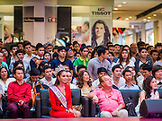 25 MARCH 2015 - BANGKOK, THAILAND: Spactators watch the first round of the Miss Tiffany's contest at CentralWorld, a large shopping mall in Bangkok. Miss Tiffany's Universe is a beauty contest for transgender contestants; all of the contestants were born biologically male. The final round will be held on May 8 in the beach resort of Pattaya. The final round is televised of the  Miss Tiffany's Universe contest is broadcast live on Thai television with an average of 15 million viewers.     PHOTO BY JACK KURTZ