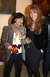 Left to right, PILAR BOXFORD and CHARLOTTE TILBURY at an exhibition of recent work by artist Lance Tilbury held at the Old Imperial Laundry, Warriner Gardens, Battersea, London on 7th December 2004.<br /><br />NON EXCLUSIVE - WORLD RIGHTS