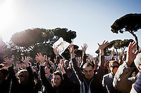 ROME, ITALY - 21 APRIL 2013: Supporters of the Five-Star Movement wave their hands during a march towards the Colosseum for a rally the day after the re-election of President Giorgio Napolitano,  in Rome, Italy, on April 21, 2013.<br /> <br /> Italy's lawmakers re-elected 87-year-old President Giorgio Napolitano on Saturday in a bid to break the country's political gridlock, as protestors outside parliament protested agains the result. Giorgio Napolitano won with a  majority of 738 ballots out of 1,007 possible votes, ahead of leftist academic Stefano Rodota, backed by the the anti-establishment Five Star Movement, who scored 217.