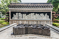 city scale model and skyline drawing at Kowloon Walled City Park in Hong Kong