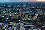 Nederland, Noord-Holland, Amsterdam, 16-01-2014; zicht op de Zuidas en de Ring A10 in de avondschemering en bij ondergaande zon. Omgeving Station Zuid-WTC, World Trade Centre (WTC) en hoofdkantoor ABN-AMRO.<br /> Verder in beeld , de woontorens Symphony 1 en 2 (onderdeel Gershwin), de Vinoly-toren en Ito-toren (onderdeel Mahler4), Atrium.<br /> Zuid-as, 'South axis', financial center in the South of Amsterdam, with o.a. headquarters of former ABN AMRO, World Trade Centre (WTC) en Ring Road A10. Amsterdam equivalent of 'the City', financial district. <br /> luchtfoto (toeslag op standaard tarieven);<br /> aerial photo (additional fee required);<br /> copyright foto/photo Siebe Swart.<br /> aerial photo (additional fee required);<br /> copyright foto/photo Siebe Swart.