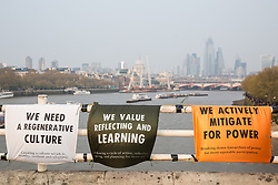 London, UK. 17th April 2019. Messages displayed by climate change activists from Extinction Rebellion on Waterloo bridge on the third day of International Rebellion activities.