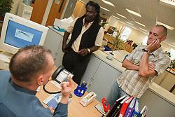 Men in office meeting.