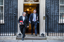 © Licensed to London News Pictures. 28/11/2017. London, UK. Home Office Minister Brandon Lewis (L) and Attorney General Jeremy Wright (R) leave 10 Downing Street after the weekly Cabinet meeting. Photo credit: Rob Pinney/LNP
