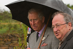 © Licensed to London News Pictures. 02/07/2012. Camborne, UK. The Duke of Cornwall and Malcolm Moyle, Chair of the Heartlands Trust at Heartlands. The Duke and Duchess of Cornwall are on a three day tour of Cornwall and the Isles of Scilly. Photo credit : Ashley Hugo/LNP
