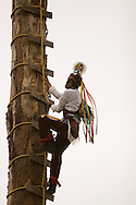The Danza de los Voladores de Cuetzalan (Dance of Cuetzalan's flyers) is a ritualistic dance in performed by the Totonac Indians. Five men, each representing the five elements of the indigenous world climb atop a pole, one of them stays on the pole playing a flute and dancing while the remaining four descend the pole with a rope tied by one of their feet. The rope unwraps itself 13 times for each of the four flyers, symbolizing the 52 weeks of the year. Cuetzalan is a small town set high in the hills in the north of the Mexican state of Puebla. It is located in the Sierra Norte region. The town itself is characterized by sloping cobbled streets and numerous rustic buildings. Feb 17 2008. (ivan gonzalez).