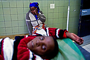 Mamaleshoane Taleng, 33, waits to see a doctor while her sister-in-law Mamakhaloana Thabeng, waits with her at the Motebang Hopital in Holtse, Lesotho. Extensive evidence demonstrates that HIV prevention initiatives that are specifically tailored to women's needs can reduce women's risk of HIV infection.
