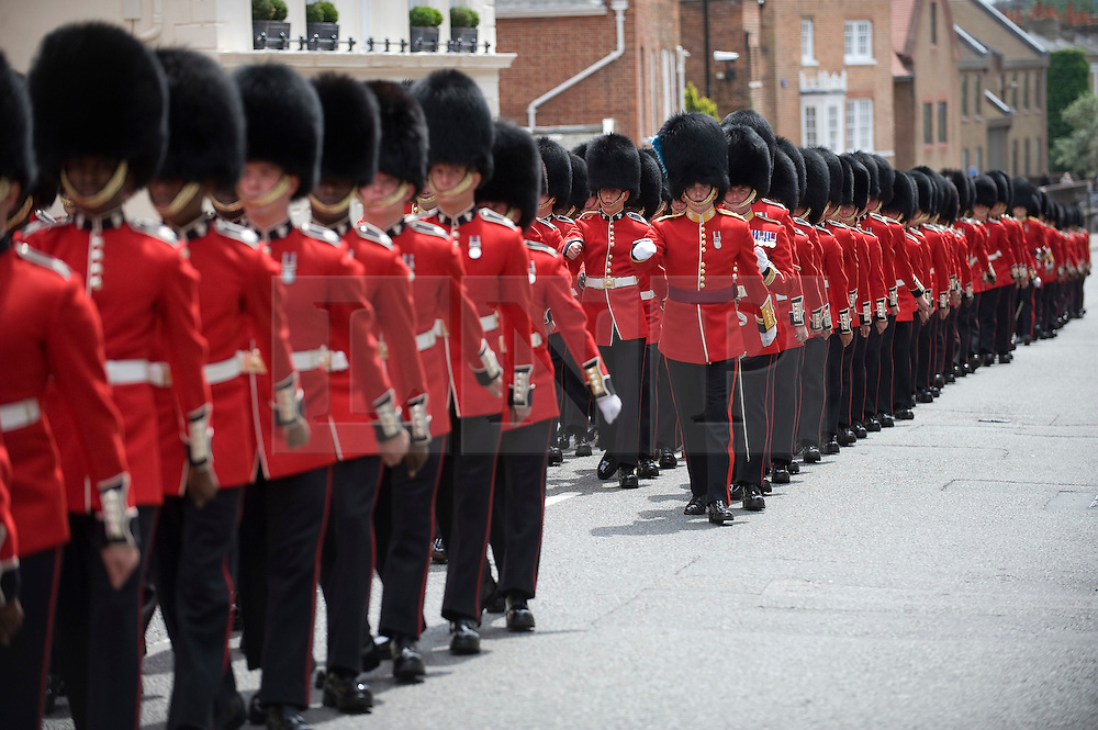 © Licensed to London News Pictures. 24/06/2011. Windsor, Berkshire. The Irish Guards march through Windsor today (24/06/2011) before the unveiling of a new statue in honour of the Windsor based regiment in the town centre, ahead of Armed forces day tomorrow. Photo credit should read: Ben Cawthra/LNP