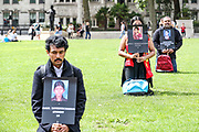 """Members of the UK Tamil Youth Organisation hold portraits of 53 school girls to remember the Sencholai bombing of Aug 14, 2006. The marking of the """"Sencholai Massacre"""" 15th anniversary is held outside Westminster Palace, Houses of Parliament in central London on Saturday, Aug 14, 2021. The UK Tami Youth Organisation called it """"an act of Genocide by the Sri Lankan state"""". (VX Photo/ Vudi Xhymshiti)"""
