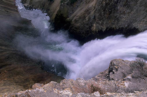 Yellowstone National Park, Water pours over edge of lower falls, Grand Canyon of Yellowstone.