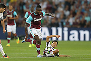 Michail Antonio of West Ham United runs past Takayuki Seto of Astra Giurgiu. UEFA Europa league, 1st play off round match, 2nd leg, West Ham Utd v Astra Giurgiu at the London Stadium, Queen Elizabeth Olympic Park in London on Thursday 25th August 2016.<br /> pic by John Patrick Fletcher, Andrew Orchard sports photography.