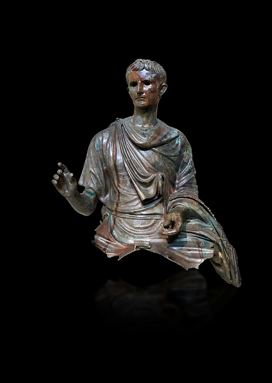 Roman bronze statue fragment of emperor Augustus, Circa 12-10 BC,  found in the Agean sea of  the Island of Euboea, Athens National Archaeological Museum. cat no X 23322. Against black<br /> <br /> The emperor Augustus is depicted in mature age mounting a horse. He wears a tunica with verivle purple stripes (clavus purpurea) fringed with a meander pattern. Icongraphic features of bthe Prima Porta and Actuim type of statue are incorporated in this brnze statue. The right hand is raised in a gesture of offical greeting and the left hand held the horses reigns. A ring on the finger gears has engraved the symbol of Pontifles Maximus assumed by Augustus in 12 BC .<br /> <br /> If you prefer to buy from our ALAMY STOCK LIBRARY page at https://www.alamy.com/portfolio/paul-williams-funkystock/greco-roman-sculptures.html . Type -    Athens    - into LOWER SEARCH WITHIN GALLERY box - Refine search by adding a subject, place, background colour, etc.<br /> <br /> Visit our ROMAN WORLD PHOTO COLLECTIONS for more photos to download or buy as wall art prints https://funkystock.photoshelter.com/gallery-collection/The-Romans-Art-Artefacts-Antiquities-Historic-Sites-Pictures-Images/C0000r2uLJJo9_s0
