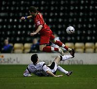 Marc Edworthy of Derby (on ground) tackles Colchester's Kem Izzet