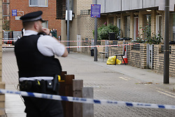 © Licensed to London News Pictures. 13/09/2021. London, UK. Police guard a cordon at Ferrey Mews in Lambeth after a man was shot dead. A murder investigation is under way following a shooting in Lambeth. At 20:57hrs on Sunday, 12 September, police were alerted by the London Ambulance Service to reports of a shooting in Ferrey Mews, SW9. Officers attended with paramedics and found two people with gunshot wounds. A 27-year-old man was pronounced dead at the scene a short time later.  Photo credit: Peter Macdiarmid/LNP