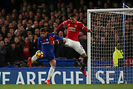 Chris Smalling of Manchester Utd flies through the air to try to stop Alvaro Morata of Chelsea getting the ball.<br /> Premier league match, Chelsea v Manchester United at Stamford Bridge in London on Sunday 5th November 2017.<br /> pic by Kieran Clarke, Andrew Orchard sports photography.