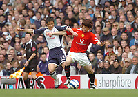 Photo: Leigh Quinnell.<br /> Tottenham Hotspur v Manchester United. The Barclays Premiership. 17/04/2006. Tottenhams Lee Young-Pyo battles with Man Utds's Park Ji-Sung.