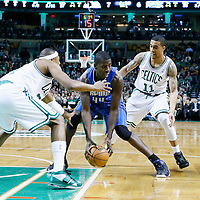 01 February 2013: Boston Celtics small forward Paul Pierce (34) and Boston Celtics shooting guard Courtney Lee (11) defend on Orlando Magic power forward Andrew Nicholson (44) during the Boston Celtics 97-84 victory over the Orlando Magic at the TD Garden, Boston, Massachusetts, USA.