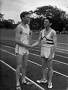 02/07/1960<br /> 07/02/1960<br /> 02 July 1960<br /> A.A.U. All-Ireland Championships 1960, Santry Stadium, Dublin. J. McLoughlin, C.S.H. A.C., (right) 2nd in the Senior Mile in a time of 4mins. 10sec. congratulates the winner, C. Shillington, D.U.H. A.C., on his winning time of 4mins. 6.7secs.