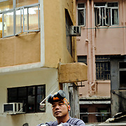Worker in Central district, Hong Kong Island, Hong Kong, China, East Asia