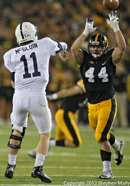 October 20 2012: Iowa Hawkeyes linebacker James Morris (44) tries to block a pass by Penn State Nittany Lions quarterback Matthew McGloin (11) during the first half of the NCAA football game between the Penn State Nittany Lions and the Iowa Hawkeyes at Kinnick Stadium in Iowa City, Iowa on Saturday October 20, 2012. Penn State defeated Iowa 38-14.