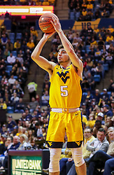 Feb 2, 2019; Morgantown, WV, USA; West Virginia Mountaineers guard Jordan McCabe (5) shoots a three pointer during the second half against the Oklahoma Sooners at WVU Coliseum. Mandatory Credit: Ben Queen-USA TODAY Sports