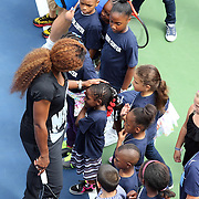 Reigning US Open champions Andy Murray and Serena Williams pose for pictures after taking part in a tennis clinic with local Queens kids affected by Hurricane Sandy. Flushing. New York, USA. 22nd August 2013. Photo Tim Clayton