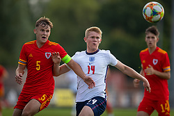 NEWPORT, WALES - Friday, September 3, 2021: Wales' Zac Williams (L) challenges England's Lewis Hall during an International Friendly Challenge match between Wales Under-18's and England Under-18's at Spytty Park. (Pic by David Rawcliffe/Propaganda)