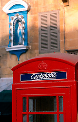MALTA GOZO VICTORIA JUL00 - A legacy of the British, a red phone box, contrasts with an icon of Holy Mary behind.. . jre/Photo by Jiri Rezac. . © Jiri Rezac 2000. . Tel:   +44 (0) 7050 110 417. Email: info@jirirezac.com. Web:   www.jirirezac.com