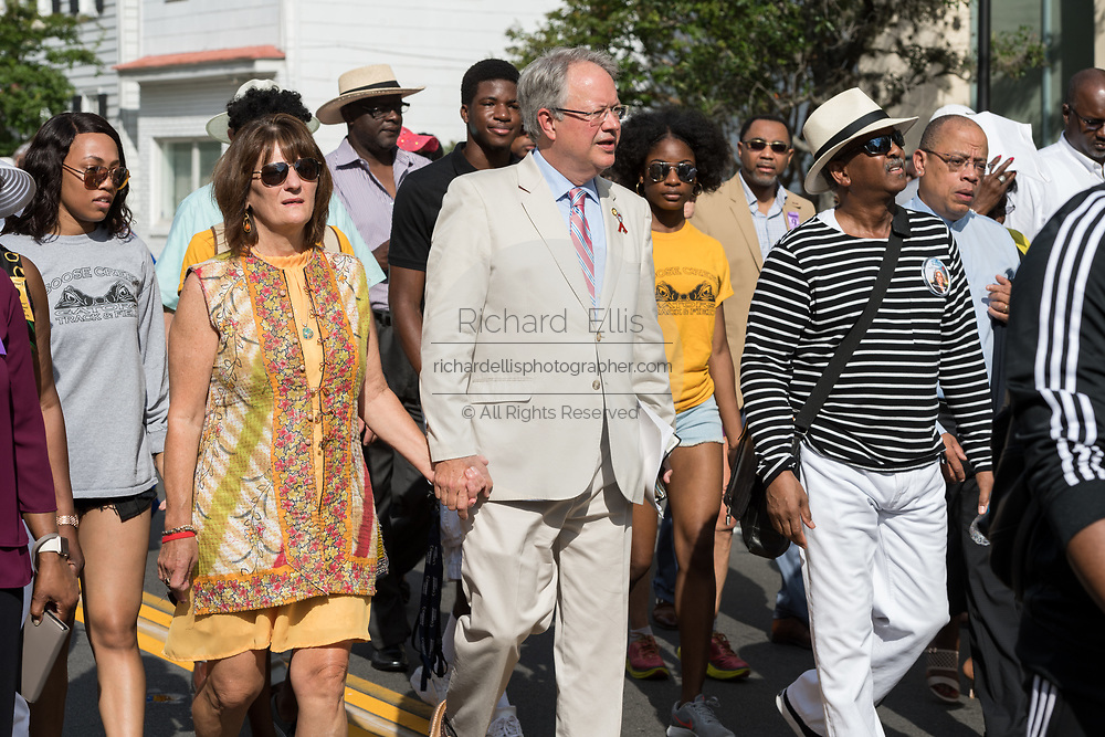 Charleston Mayor John Tecklenburg, center, joins the Hate Won't Win Unity walk to the Mother Emanuel African Methodist Episcopal Church marking the 2nd anniversary of the mass shooting June 17, 2017 in Charleston, South Carolina. Nine members of the historic African-American church were gunned down by a white supremacist during bible study on June 17, 2015.