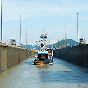 Inside the Miraflores Locks on the southern end of the Panama Canal. Opened in 1914, the Panama Canal is a crucial shipping lane between the Atlantic and Pacific Oceans that mean that ships don't have to go around the bottom of South America or over the top of Canada. The Canal was originally built and owned by the United States but was handed back to Panama in 1999.