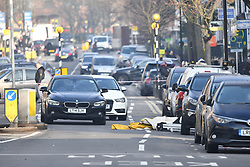 © Licensed to London News Pictures. 21/02/2018. London, UK. Two abandoned cars at the scene on Malden Road, Camden, where one of two stabbings took place yesterday evening, killing two young men. Police were called to a second disturbance in the area, in which a second man was stabbed to death, and are currently investigating if the two incidents are connected. Photo credit: Ben Cawthra/LNP