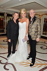 Left to right, JULIEN MACDONALD, JOHN CAUDWELL and CLAIRE CAUDWELL at a birthday dinner for Claire Caudwell for family & friends held at The Dorchester, Park Lane, London on 24th January 2014.