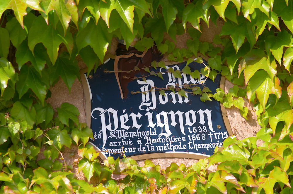 A painted street sign saying Rue Dom Perignon born in Saint Menehould 1638, arrived in Hautvillers in 1668, dead 1715, inventor of the champagne method, the village of Hautvillers in Vallee de la Marne, Champagne, Marne, Ardennes, France