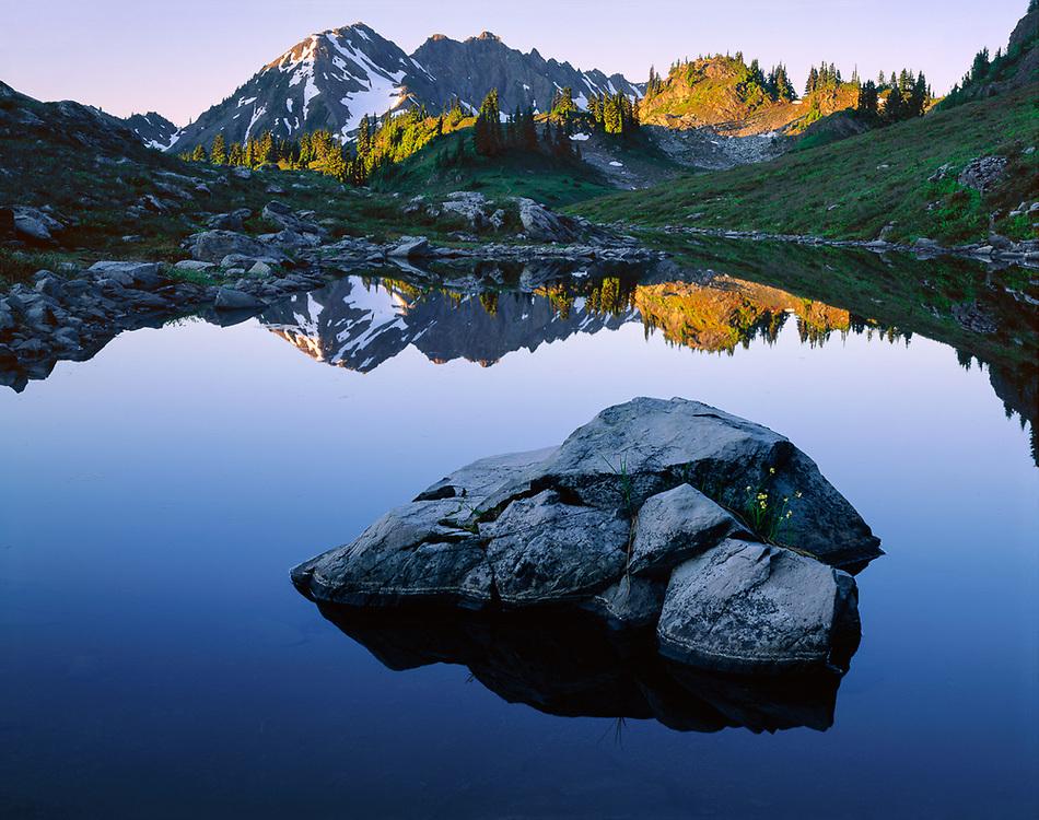 Olympic National Park, Washington, USA. Lake Lacrosse reflects Mount Duckabush, early morning light.