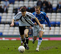 Photo: Leigh Quinnell.<br /> Birmingham City v Newcastle United. The FA Cup. 06/01/2007. Birminghams GaryMcSheffrey pulls the shirt of Newcastles  James Milner.