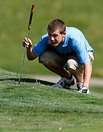 Heritage High's Ryan Volta lines up a putt on 15 at the BVAL golf championship at Roddy Ranch Golf Course on Monday, April 30, 2012. (Photo by Kevin Bartram)