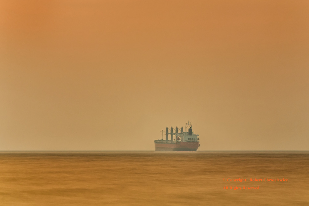 Yellow Dusk: Heavy smoke from local fires fill the sky and make for a most unusual yellow dusk, Vancouver British Columbia Canada.