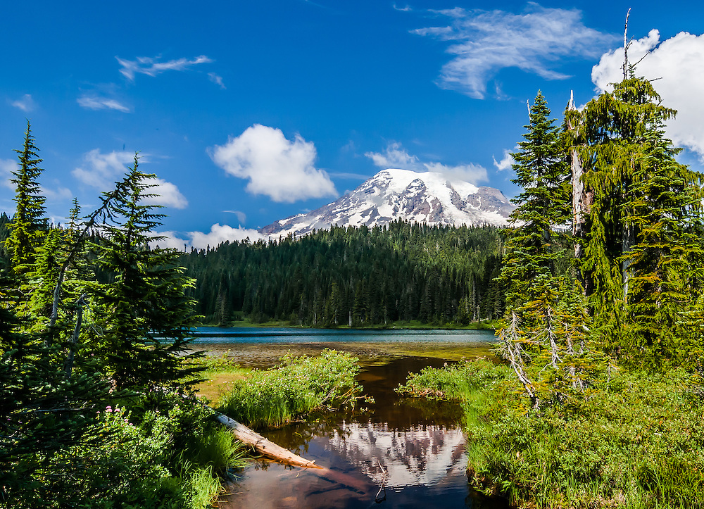 SUBJECT: Mount Rainier IMAGE: Altitude 14,400 feet. Mount Rainier, an active volcano, reflects in the tranquil waters.