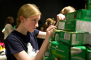 Elizabeth Brannon, age 13, puts the finishing pieces on Team Dewberry's creation at the Cookie Box Creations design contest presented by the Girl Scouts of Northeast Texas at the Perot Museum of Nature & Science on Sunday, February 17, 2013 in Dallas, Texas. (Cooper Neill/The Dallas Morning News)