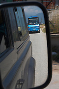 A tour bus in the rear view mirror. Drama, Macedonia, Greece