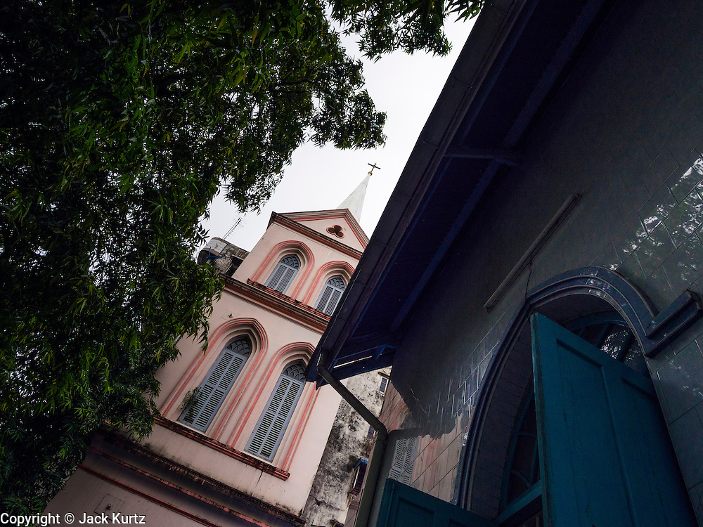 08 JUNE 2014 - YANGON, MYANMAR: The spire for St. John's Catholic Church in Yangon. It was built in 1900 and was one of the first Catholic churches built in Yangon. Yangon has the highest concentration of colonial style buildings still standing in Asia. Efforts are being made to preserve the buildings but many are in poor condition and not salvageable.     PHOTO BY JACK KURTZ